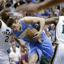 Denver Nuggets' Danilo Gallinari, center, drives to the basket as Utah Jazz's Marvin Williams (2) and teammate Derrick Favors (15) defend in the second quarter during an NBA basketball game on Wednesday, April 3, 2013, in Salt Lake City. (AP Photo/Rick Bowmer)
