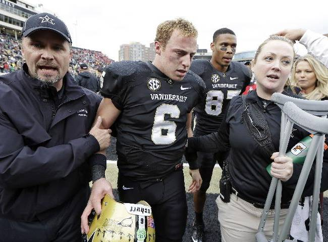 Vanderbilt quarterback Austyn Carta-Samuels (6) leaves the field after Vanderbilt upset No. 15 Georgia 31-27 in an NCAA college football game on Saturday, Oct. 19, 2013, in Nashville, Tenn. Cara-Samuels injured his leg in the second quarter and watched the remainder of the game from the sideline