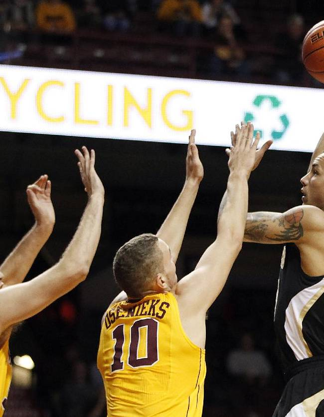 Wofford forward Lee Skinner, right, goes to the basket against Minnesota forward Oto Osenieks (10) and center Elliott Eliason (55) in the first half of an NCAA college basketball game Thursday, Nov. 21, 2013, in Minneapolis