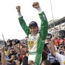 Ed Carpenter is lifted by his crew as he celebrates winning the pole position for the Indianapolis 500 auto race on the first day of qualifications at Indianapolis Motor Speedway in Indianapolis, Saturday, May 18, 2013. Carpenter won the pole with a speed of 228.76 mph. (AP Photo/AJ Mast)