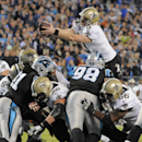 New Orleans Saints' Drew Brees (9) dives over the goal line for a touchdown against the Carolina Panthers in the second half of an NFL football game in Charlotte, N.C., Thursday, Oct. 30, 2014. (AP Photo/Mike McCarn)