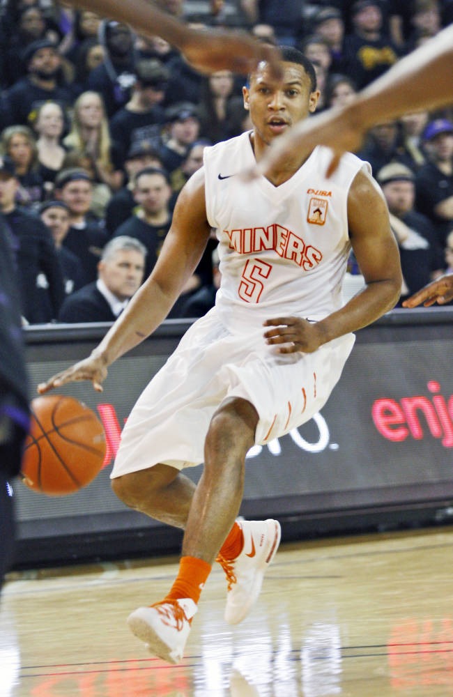 UTEP's C.J. Cooper (5) dribbles the ball against East Carolina during an NCAA college basketball game Thursday, Feb. 6, 2014, in Greenville, N.C