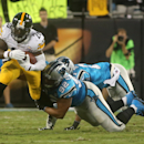 Pittsburgh Steelers' Le'Veon Bell (26) is brought down by Carolina Panthers' Dwan Edwards (92) and Thomas DeCoud (21) during an NFL football game Sunday, Sept. 21, 2014, in Charlotte, N.C The Associated Press