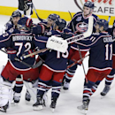 Columbus Blue Jackets goalie Sergei Bobrovsky (72) is swarmed by teammates after winning a 4-3 shootout against the Pittsburgh Penguins during an NHL hockey game in Columbus, Ohio Saturday, Dec. 13, 2014 The Associated Press