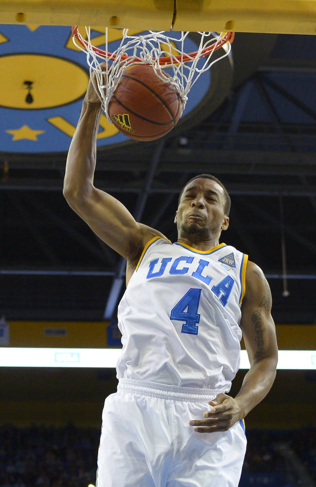 UCLA guard Norman Powell dunks during the first half of an NCAA college basketball game against Oregon State, Sunday, March 2, 2014, in Los Angeles