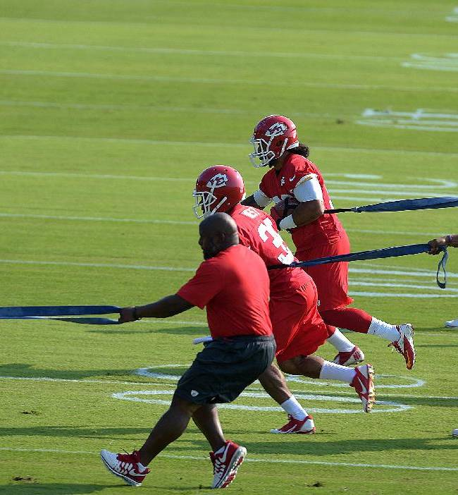 Kansas City Chiefs backs De'Anthony Thomas (1), Charcandrick West (35), center,  and Jordan Campbell (38), center rear, run through a drill Monday morning July 21, 2014 on the Missouri Western State University campus in St. Joseph. Mo