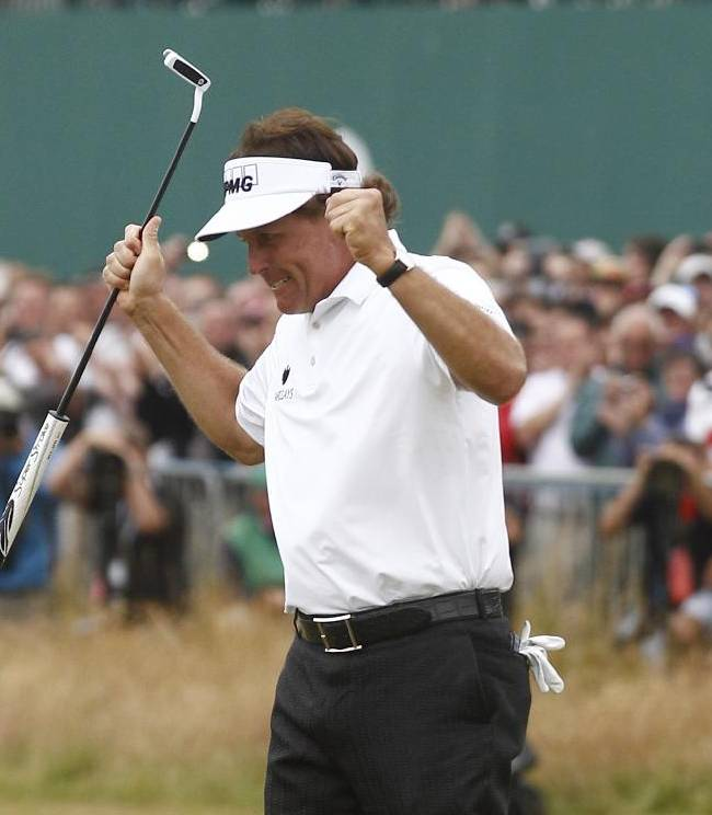 In this July 21, 2013 file photo, Phil Mickelson  celebrates after his final putt on the 18th green during the final round of the British Open Golf Championship at Muirfield, Scotland. Every major championship features a signature shot, some easier to define than others. And with every major champion, there is another shot that is equally pleasing to them even if hardly anyone else noticed