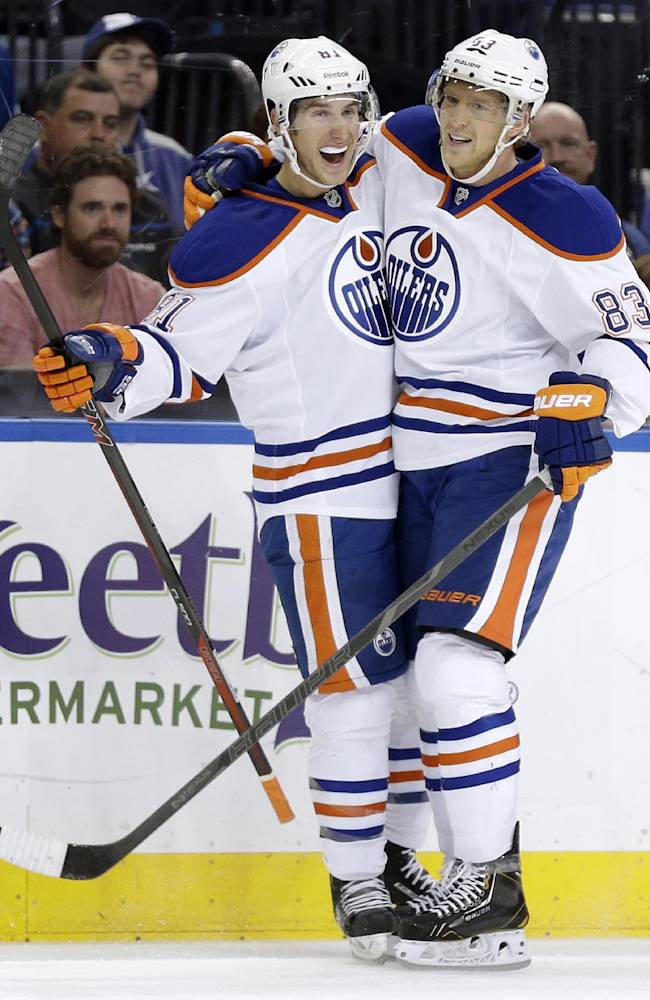 Edmonton Oilers defenseman Taylor Fedun (81) celebrates with teammate right wing Ales Hemsky (83), of the Czech Republic, after scoring against the Tampa Bay Lightning during the first period of an NHL hockey game on Thursday, Nov. 7, 2013, in Tampa, Fla