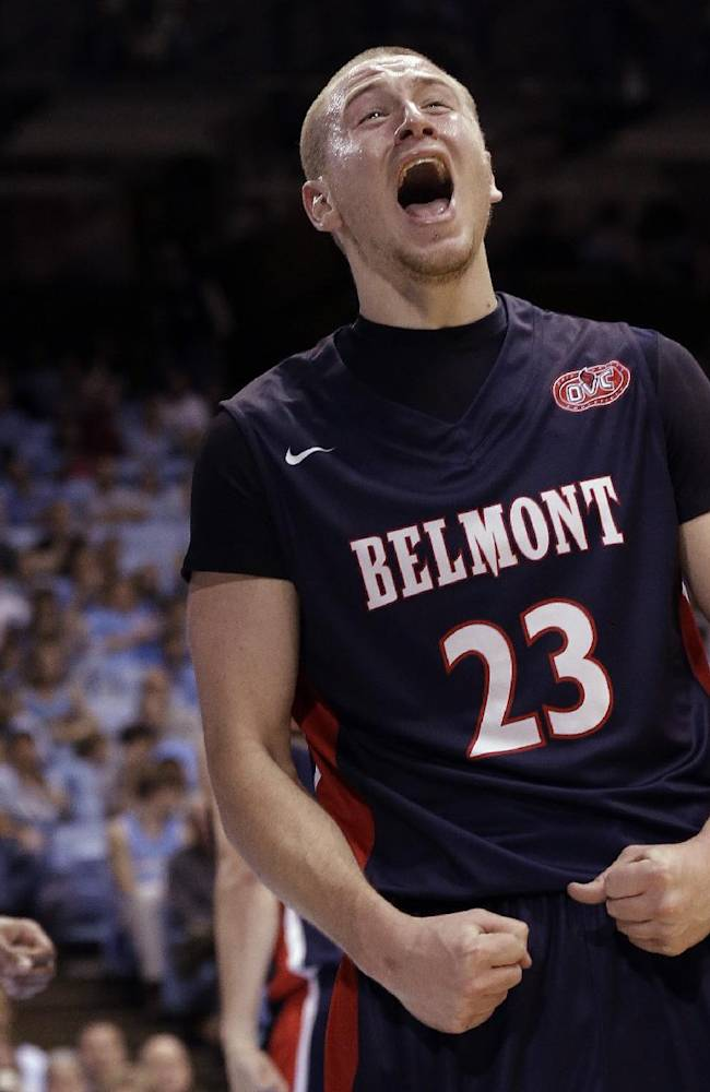 Belmont's Craig Bradshaw (23) reacts following a basket against North Carolina during the second half of an NCAA college basketball game in Chapel Hill, N.C., Sunday, Nov. 17, 2013. Belmont won 83-80. North Carolina's James Michael McAdoo walks away at rear