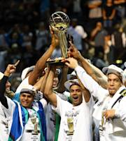 SAN ANTONIO, TX - JUNE 15: The San Antonio Spurs celebrate with the Larry O'Brien trophy after defeating the Miami Heat to win the 2014 NBA Finals at the AT&T Center on June 15, 2014 in San Antonio, Texas. (Photo by Andy Lyons/Getty Images)