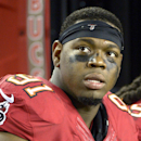 This Oct., 24, 2013, file photo shows Tampa Bay Buccaneers defensive end Da'Quan Bowers (91) on the bench during the second half of an NFL football game against the Carolina Panthers in Tampa, Fla. The NFL has suspended Bowers for two games without pay f