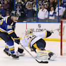 St. Louis Blues defenseman Kevin Shattenkirk fakes out Nashville Predators goaltender Carter Hutton to score the decisive goal in a shootout during a game between the St. Louis Blues and the Nashville Predators on Thursday, Jan. 29, 2015, at the Scottrade