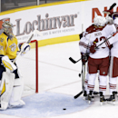 Nashville Predators goalie Pekka Rinne (35), of Finland, looks on as Arizona Coyotes players celebrate after a goal by left wing Rob Klinkhammer in the first period of an NHL hockey game Tuesday, Oct. 21, 2014, in Nashville, Tenn The Associated Press