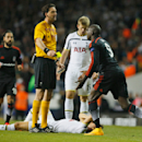 Besiktas' Demba Ba, right is shown a yellow card by referee Manuel Grafe, during the Europa League group C soccer match between Tottenham Hotspur and Besiktas, at Tottenham's White Hart Lane stadium, in London, Thursday, Oct. 2, 2014