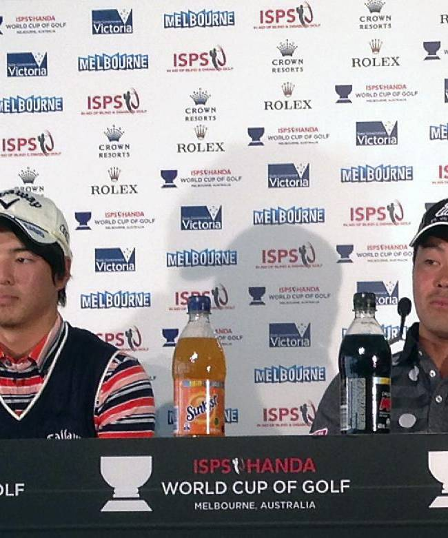 Japan's Ryo Ishikawa, left, and Hideto Tanihara attend a press conference in Melbourne, Australia, Tuesday, Nov. 19, 2013, ahead of the World Cup of Golf at Royal Melbourne gold club.  Ishikawa is making his second trip to Royal Melbourne with fond memories of the course from the 2011 Presidents Cup and as part of a strong Asian contingent for this week's World Cup