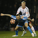 Fulham's Jack Grimmer, rear, vies for the ball with Sunderland's Steven Fletcher during the English FA Cup fourth round replay soccer match between Fulham and Sunderland at Craven Cottage stadium in London, Tuesday, Feb. 3, 2015