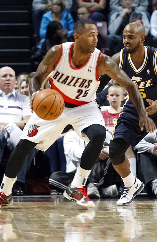 Portland Trail Blazers point guard Mo Williams (25) drives the ball against Utah Jazz point guard John Lucas III (5) in the first half of a preseason NBA basketball game on Friday, Oct. 11, 2013, in Boise, Idaho