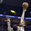 Memphis Grizzlies' Marc Gasol, of Spain, right, shoots over Utah Jazz's Paul Millsap (24) during the first half of an NBA basketball game in Memphis, Tenn., Wednesday, April 17, 2013. (AP Photo/Danny Johnston)