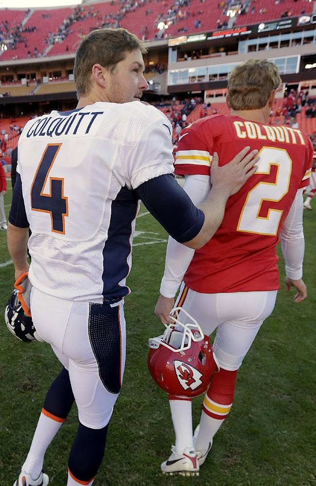In this Nov. 25, 2012 file photo, Kansas City Chiefs punter Dustin Colquitt (2) and his brother, Denver Broncos punter Britton Colquitt (4) talk after playing each other in an NFL football game, in Kansas City, Mo. The Colquitts are to punting what the Mannings are to passing, and this first family of punters had an inauspicious start, a safety on the patriarch's very first punt at the University of Tennessee in 1975