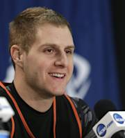 Mercer's Kevin Canevari smiles as he answers a question during a news conference at an NCAA college basketball tournament in Raleigh, N.C., Saturday, March 22, 2014. Mercer plays Tennessee in a third-round game on Sunday. (AP Photo/Gerry Broome)