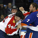 Florida Panthers defenseman Erik Gudbranson (44) and New York Islanders defenseman Matt Carkner (7) fight during the first period of an NHL hockey game at Nassau Coliseum in Uniondale, N.Y., Tuesday, April 1, 2014 The Associated Press