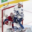 Toronto Maple Leafs' James van Riemsdyk (21) reacts as he takes in a shot while screening Montreal Canadiens goalie Carey Price during second period NHL hockey action Saturday, Feb. 28, 2015 in Montreal. (AP Photo/The Canadian Press, Paul Chiasson)