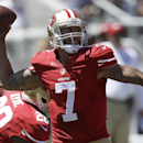 In this Aug. 17, 2014, file photo, San Francisco 49ers quarterback Colin Kaepernick (7) passes against the Denver Broncos during the first quarter of an NFL preseason football game in Santa Clara, Calif. Kaepernick is locked up long-term and he will have