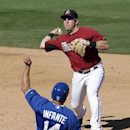 Arizona Diamondbacks shortstop Cliff Pennington, right, throws to first for the double play as Kansas City Royals' Omar Infante (14) slides in late to second base during the sixth inning of an exhibition spring training baseball game Wednesday, March 5, 2