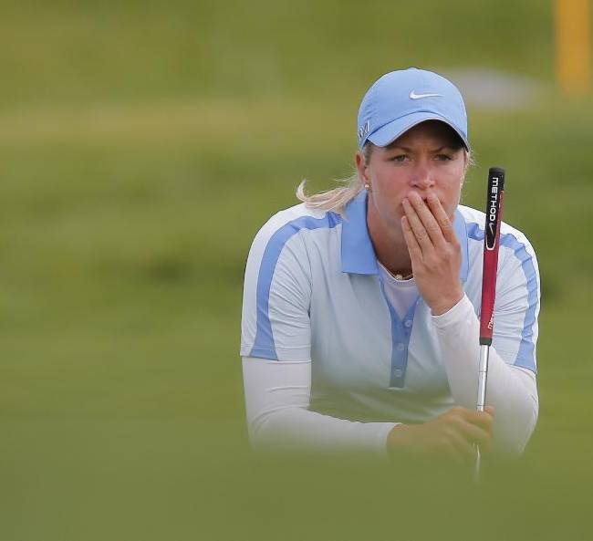 Suzann Pettersen of Norway studies her putt before playing on the 18th hole during the last round of the Evian Championship women's golf tournament in Evian, eastern France, Sunday, Sept. 15, 2013