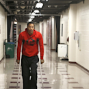 Chicago Bulls NBA basketball player Derrick Rose walks down the hall on crutches to a news conference about his injured knee at the United Center Thursday, Dec. 5, 2013, in Chicago The Associated Press