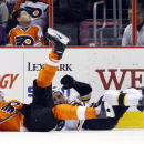 Philadelphia Flyers' Vincent Lecavalier, left, and Boston Bruins' Johnny Boychuk collide during the first period of an NHL hockey game, Sunday, March 30, 2014, in Philadelphia The Associated Press