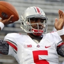 FILE - In this Oct. 27, 2012, file photo, Ohio State quarterback Braxton Miller warms up before an NCAA college football game against Penn State in State College, Pa. Ohio State concludes its 15 spring practices with an intrasquad scrimmage on Saturday, April 12, 2013 when the Buckeyes bus to Cincinnati to play at Paul Brown Stadium. The team has been split into two squads by coach Urban Meyer and his staff with quarterbacks Braxton Miller and Kenny Guiton off limits for contact. (AP Photo/Gene J. Puskar, File)