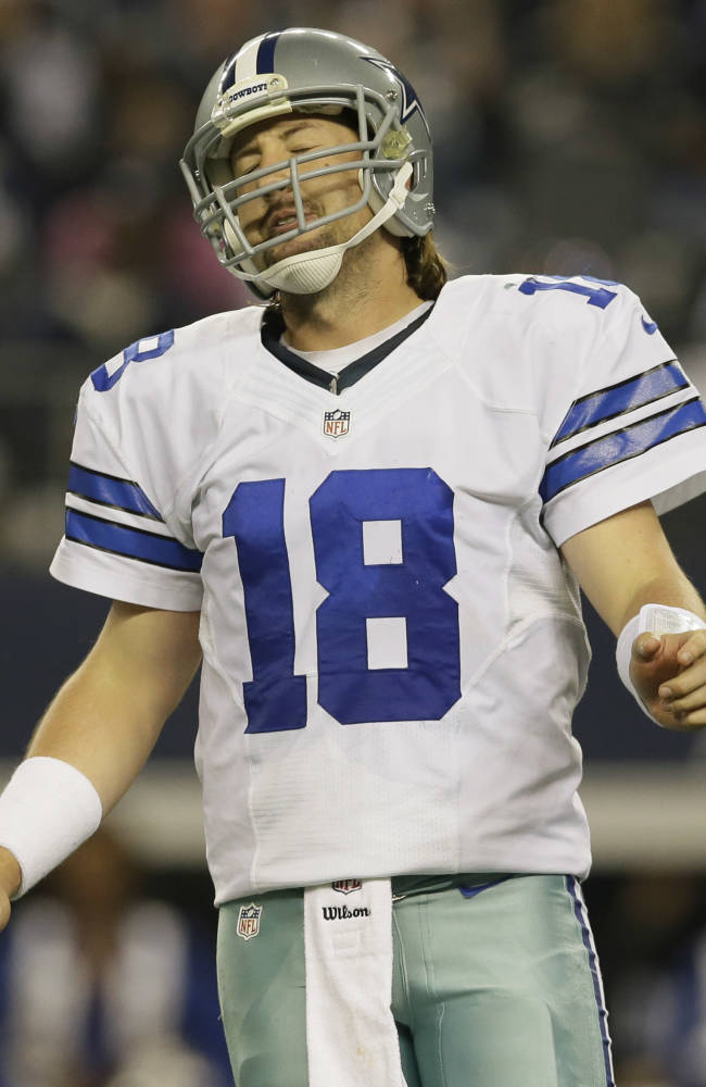 Dallas Cowboys quarterback Kyle Orton (18) reacts after throwing a pass for a loss of yards against the Philadelphia Eagles during the second half of an NFL football game, Sunday, Dec. 29, 2013, in Arlington, Texas