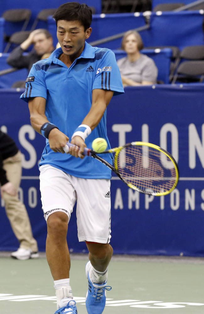 Lu Yen-Hsun, of Taiwan, hits a return to Alex Kuznetsov, of the United States, in the quarterfinals at the U.S. National Indoor Tennis Championships on Friday, Feb. 14, 2014 in Memphis, Tenn