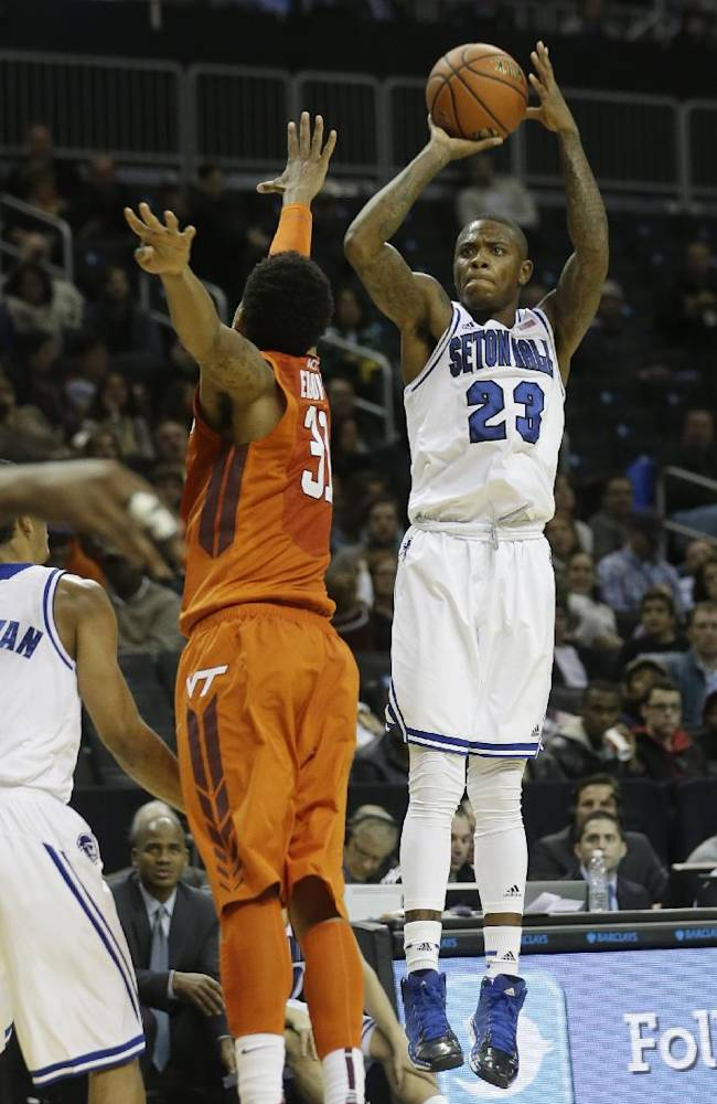 Seton Hall's Fuquan Edwin (23) shoots a three-point basket over Virginia Tech's Jarell Eddie during the second half of a consolation game in the Coaches vs. Cancer NCAA college basketball game on Saturday, Nov. 23, 2013, in New York. Seton Hall won the game 68-67