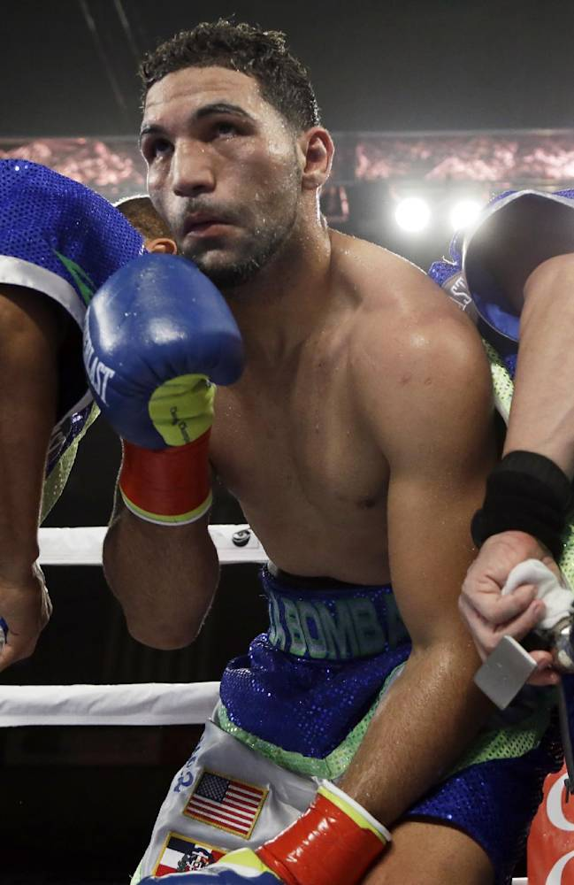 Edwin Rodriguez, of the Dominican Republic, answers the bell for the eighth round of super middleweight championship boxing match against Andre Ward in Ontario, Calif., Saturday, Nov. 16, 2013. Ward won by unanimous decision