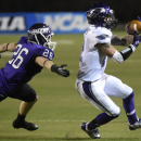 Mount Union's Nick Rodriguez (26) defends Wisconsin-Whitewater receiver Justin Howard during the second half of the NCAA Division III championship college football game at Salem Stadium in Salem, Va., Friday Dec. 19, 2014. Whitewater won 43-34 The Associ