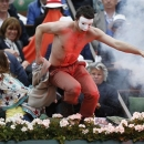 A demonstrator tries to invade center court as Spain's Rafael Nadal plays 136compatriot David Ferrer during the men's  final match of the French Open tennis tournament at the Roland Garros stadium Sunday, June 9, 2013 in Paris. (AP Photo/Petr David Josek)