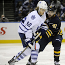 Toronto Maple Leafs' William Nylander (62) skates in on Buffalo Sabres' Andrej Meszaros (41), of Slovakia, during the second period of an NHL hockey preseason game, Friday, Sept. 26, 2014, in Buffalo, N.Y. The Associated Press