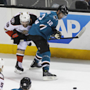 Anaheim Ducks' Patrick Maroon, left and San Jose Sharks' Patrick Marleau struggle for the puck during the third period of an NHL hockey game, Saturday, Nov. 29, 2014, in San Jose, Calif. The Sharks beat the Ducks 6-4 The Associated Press