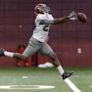 Alabama wide receiver Christion Jones (22) has one slip through his fingers as he works through passing drills during Alabama football practice, Wednesday, Aug. 27, 2014, at the Hank Crisp Indoor Facility in Tuscaloosa, Ala The Associated Press