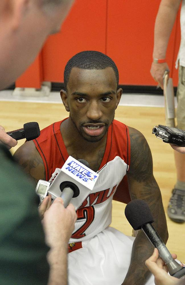 Louisville's Russ Smith answers questions from the media during NCAA college basketball media day, Saturday, Oct. 12, 2013, in Louisville, Ky