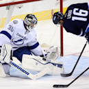 Tampa Bay Lightning goaltender Ben Bishop (30) stops Winnipeg Jets' Andrew Ladd (16) during the first period of an NHL hockey game Friday, Oct. 24, 2014, in Winnipeg, Manitoba. (AP Photo/The Canadian Press, Trevor Hagan)