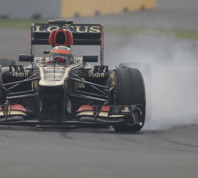 Lotus driver Kimi Raikkonen of Finland brakes as he steers his car during the second practice session at the Indian Formula One Grand Prix at the Buddh International Circuit in Noida, India, Friday, Oct. 25, 2013