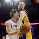 Houston Rockets' Omer Asik, left, battles Los Angeles Lakers' Chris Kaman, right, for a rebound during the first quarter of an NBA basketball game Thursday, Nov. 7, 2013, in Houston The Associated Press