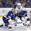 Vancouver Canucks defenseman Frank Corrado (26) watches the puck go past Tampa Bay Lightning goalie Ben Bishop (30) for a goal during the third period of an NHL hockey game Tuesday, Jan. 20, 2015, in Tampa, Fla. The Lightning won 4-1 The Associated Press