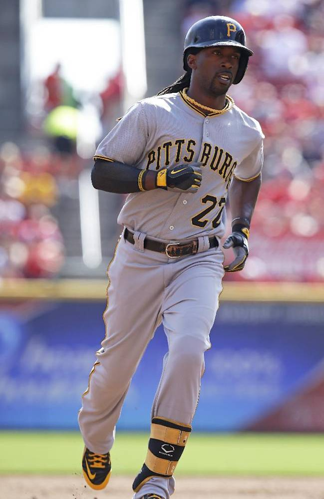 Pittsburgh Pirates' Andrew McCutchen rounds the bases after hitting a solo home run off Cincinnati Reds starting pitcher Bronson Arroyo in the third inning of a baseball game, Saturday, Sept. 28, 2013, in Cincinnati