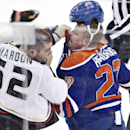 Anaheim Ducks Patrick Maroon (62) fights Edmonton Oilers Matt Hendricks (23) during second period NHL hockey action in Edmonton, Alberta, on Sunday April 6, 2014 The Associated Press