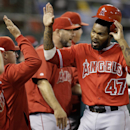 Crisp scores on wild pitch as A's beat Angels 2-1 The Associated Press