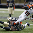 Cincinnati Bengals wide receiver A.J. Green (18) is tackled by New Orleans Saints free safety Rafael Bush (25) and defensive back A.J. Davis (20) in the second half of an NFL football game in New Orleans, Sunday, Nov. 16, 2014. (AP Photo/Rogelio Solis)